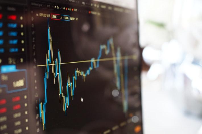 Dow Hits Record High for Economy Stocks; Nasdaq Dips