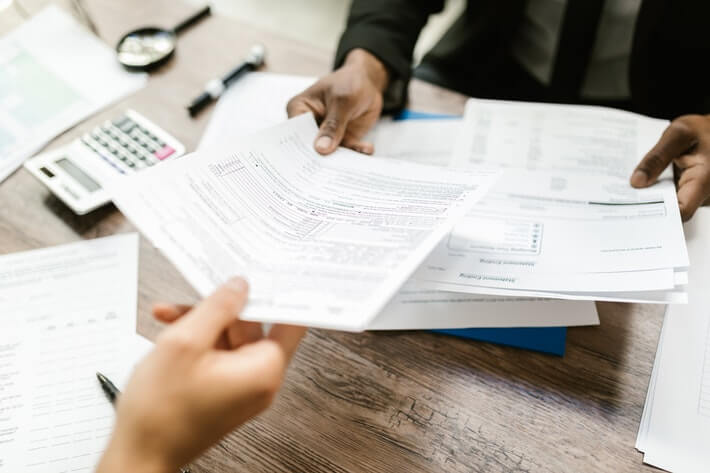 Pros and Cons of Debt Relief: Should You Use Debt Reduction Services?